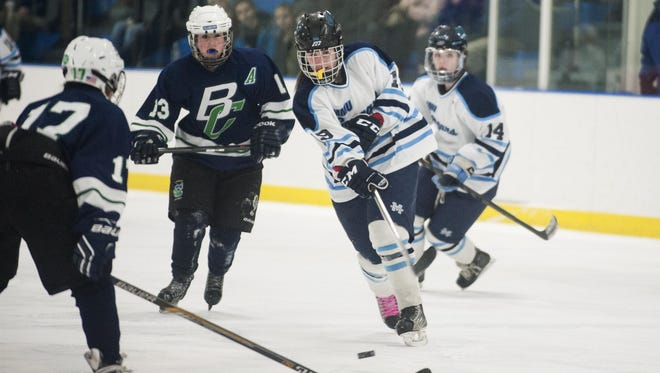 MMU's Anna Burke (19) takes a shot during a girl playoff hockey game last season.