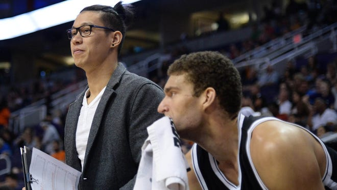 Brooklyn Nets guard Jeremy Lin (left) looks on next to Brooklyn Nets center Brook Lopez (right) during the second half against the Phoenix Suns at Talking Stick Resort Arena. The Nets won 122-104.