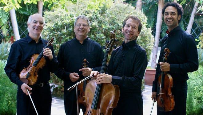 Fine Arts Quartet: violinists Ralph Evans and Efilm Boico, cellist Robert Cohen and violist Juan-Miguel Hernandez.