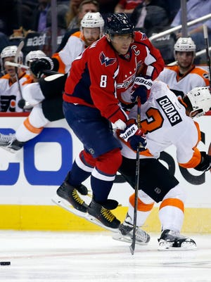 Capitals left wing Alex Ovechkin (8) collides with Flyers defenseman Radko Gudas during the second period of Game 1.