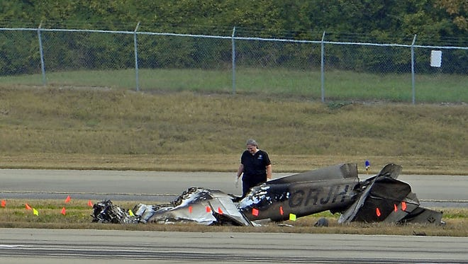 Investigators examine a small plane that crashed at Nashville International Airport early in the morning on Oct. 29.