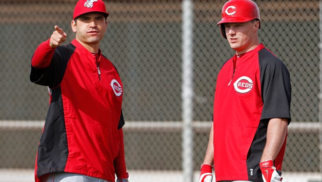 The Reds' Joey Votto, left, and Jay Bruce watch live batting practice during spring training.
