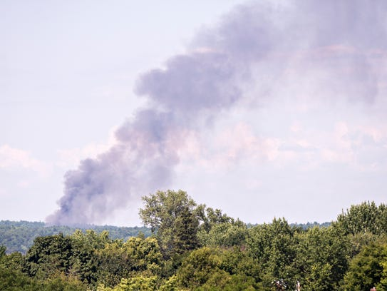 Smoke rises from a brush fire in Colchester on Tuesday,