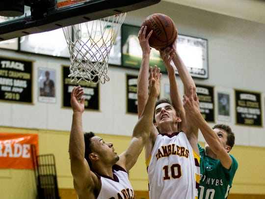Loyola Matthew Sechman catches a rebound against Fort Myers during Gulfshore Holiday Hoopfest at Golden Gate High School on Wednesday, Dec. 28, 2016. Loyola beat Fort Myers with a final score of 61-44.
