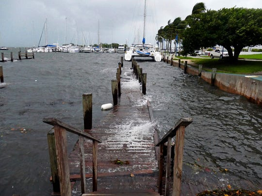 Docks at Grove Harbour Marina get battered by winds and surf as high tide begins to roll in with strong winds as Hurricane Irma approaches, on Saturday, Sept. 9, 2017.