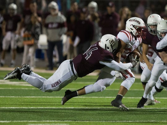 Ray's Julian Mireles is tackled by Flour Bluff's Javaris