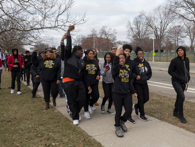 Martin Luther King Jr. High School students march across