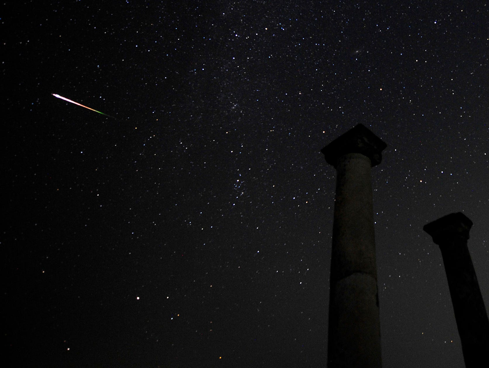 A meteor streaks across the sky above the Stobi archaeological site in Skopje, Macedonia.