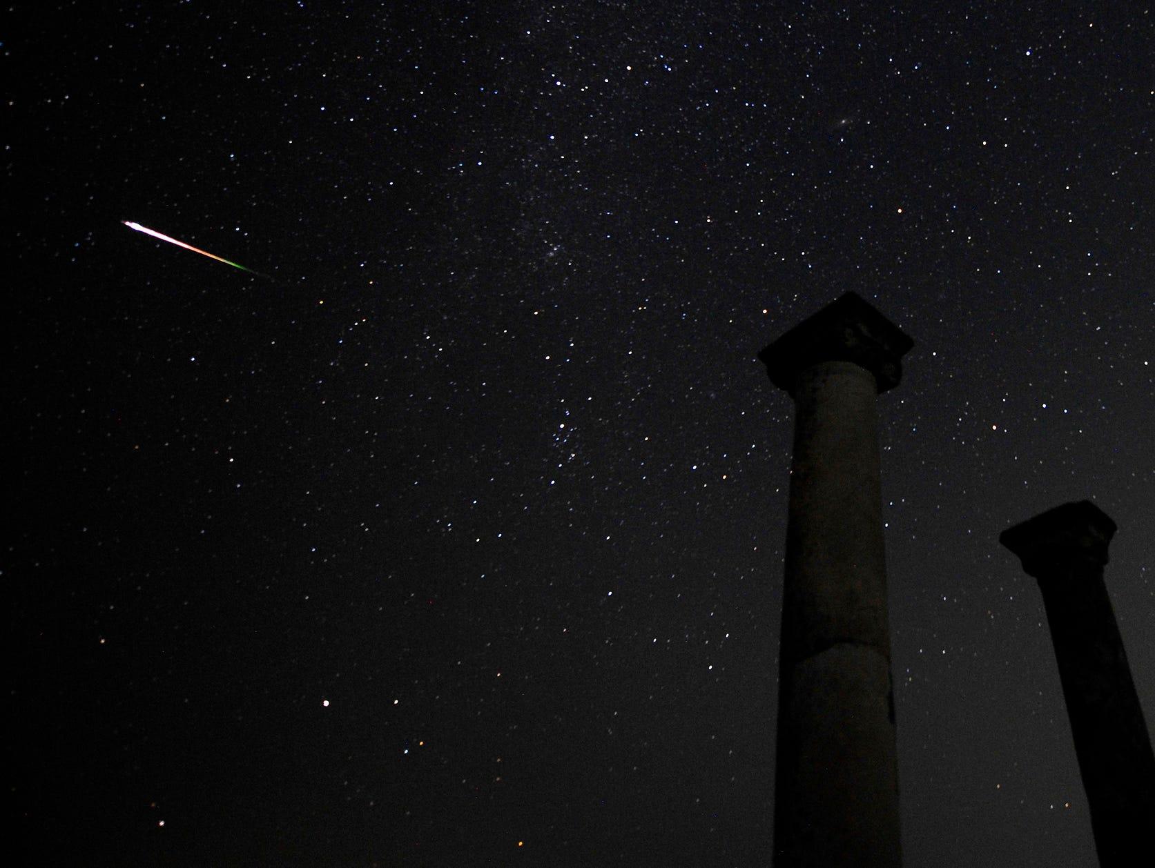 A meteor streaks across the sky above the Stobi archaeological site in Skopje, Macedonia.