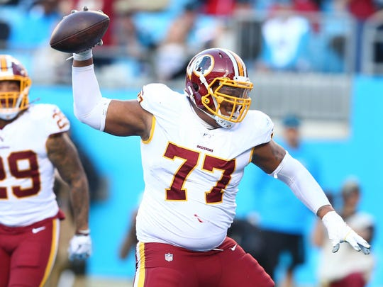 Dec 1, 2019; Charlotte, NC, USA; Washington Redskins offensive guard Ereck Flowers (77) spikes the ball after running back Derrius Guice (29) scored a touchdown during the fourth quarter against the Carolina Panthers at Bank of America Stadium. Mandatory Credit: Jeremy Brevard-USA TODAY Sports