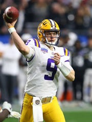 LSU quarterback Joe Burrow (9) throws a pass during the second half of a Fiesta Bowl NCAA college football game against UCF Tuesday, Jan. 1, 2019, in Glendale, Ariz. LSU defeated UCF 40-32. (AP Photo/Ross D. Franklin)