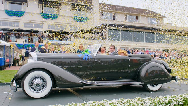 Joseph Cassini, his daughter Caroline and wife Margie celebrate winning the Best of Show Award at the Pebble Beach Concours d'Elegance in 2013. At that time, the 1934 Packard 1108 Twelve Dietrich Convertible Victoria was the first American-built automobile to win Best of Show at Pebble Beach in 25 years.