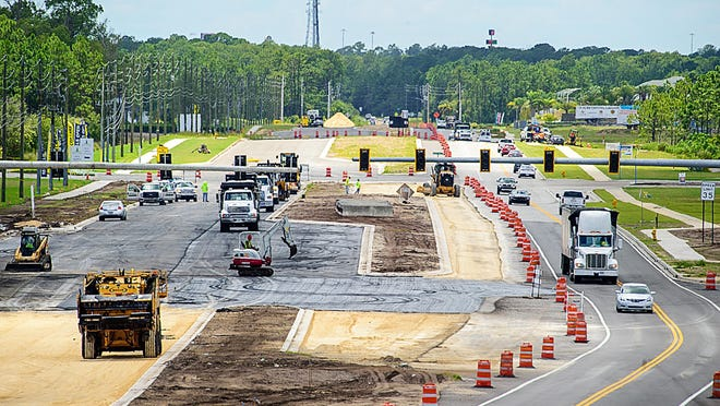 Construction continues on improvements on County Road 210 in front of the Beachwalk development, west of U.S. 1, on Monday. Road and intersection improvements costing $7.25 million on C.R. 210 from U.S. 1 to Interstate 95 are part of St. Johns County's Capital Improvement Program.