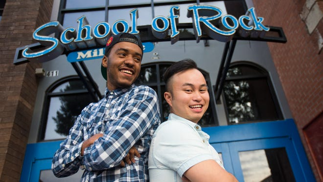 JT Holmes (left), 19, and Luis Basilio, 26, stand outside School of Rock in Tempe Jan. 20, 2015. The two men are successful hosting 18 and over parties at the club on Mill Avenue.