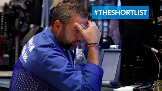 Trader Kevin Lodewick works on the floor of the New York Stock Exchange, Friday, Aug. 21, 2015. The Dow Jones industrial average suffered another big drop Monday after plunging more than 530 points Friday.