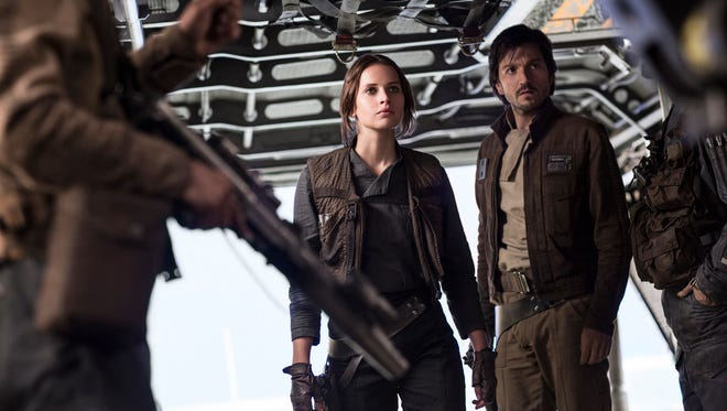 Jyn Erso (Felicity Jones) and Cassian Andor (Diego Luna) have plans to steal in 'Rogue One: A Star Wars Story.'