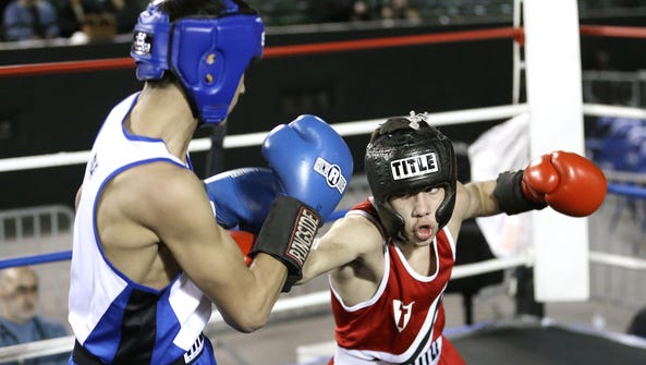 Jorge Madrid, right, of the Palomas Mexico Boxing Club,