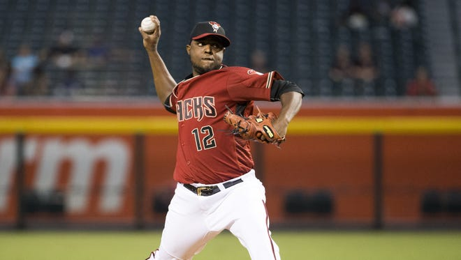 Arizona Diamondbacks starting pitcher Rubby De La Rosa throws against the Colorado Rockies during the first inning at Chase Field in Phoenix on September 14, 2016.