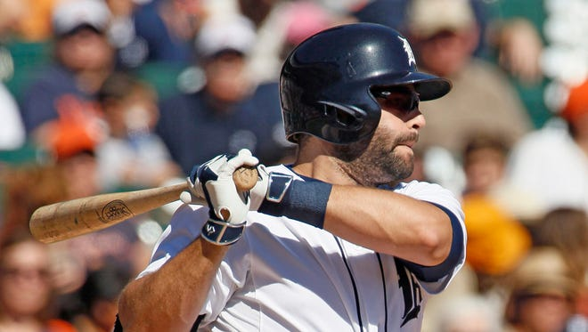 Alex Avila #13 of the Detroit Tigers hits a grounder for an out but drives in J.D. Martinez against the Chicago White Sox during the third inning at Comerica Park on September 23, 2015 in Detroit, Michigan.
