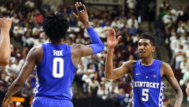 Mar 4, 2017; College Station, TX, USA; Kentucky Wildcats guard Malik Monk (5) celebrates with guard De'Aaron Fox (0) after a play during the second half against the Texas A&M Aggies at Reed Arena.
