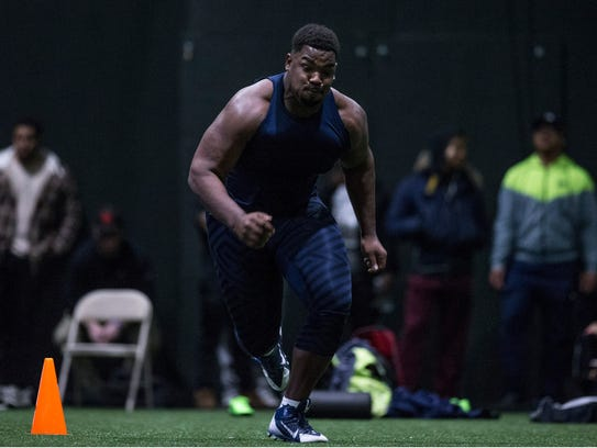 Former Monmouth center Alex Thompson works out for NFL scouts at the school's Pro Day.