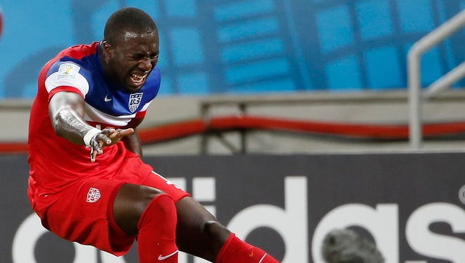 United States forward Jozy Altidore (17) grabs his leg while falling to the ground during the first half of their 2014 World Cup game against Ghana at Estadio das Dunas.