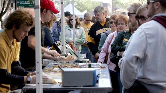 A long line forms for breakfast burritos at the Farm Boys Hearty Food Co. booth.