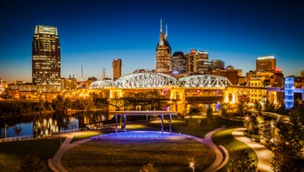 Cumberland Park with Shelby Street Walking Bridge and skyline of Nashville, Tennessee, USA