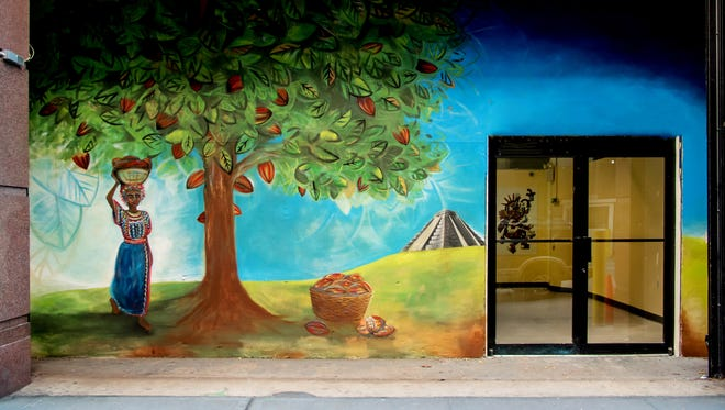 A Brooklyn artist painted a mural inspired by a Yucatan cacao plantation at the entrance of Choco-Story New York.