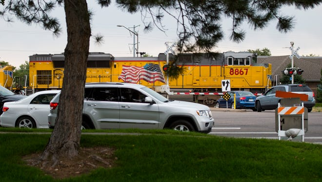 A train blocks traffic as it passes through the intersection of Lemay and Riverside Tuesday, Aug. 19, 2015.