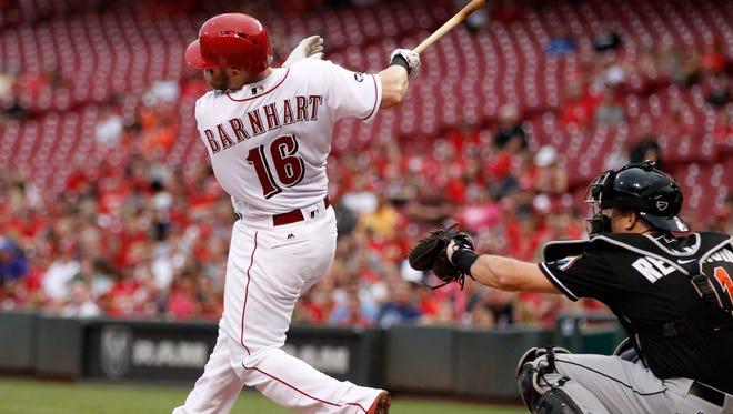 Cincinnati Reds catcher Tucker Barnhart (16) knocks a grand slam home run off Miami Marlins starting pitcher Jose Urena during the first inning of a baseball game, Tuesday, Aug. 16, 2016, in Cincinnati.
