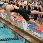 Allie Wooden leaps off the block to start the opening leg of the 200-yard freestyle relay at state.