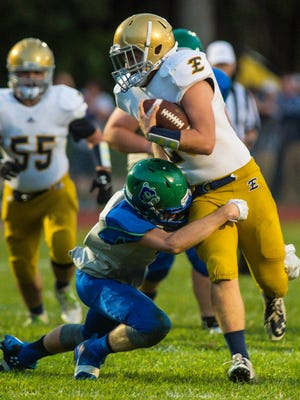 Colchester's Thomas Soons, left, tackles Essex's Liam Coulter in Colchester on Friday, September 2, 2016.