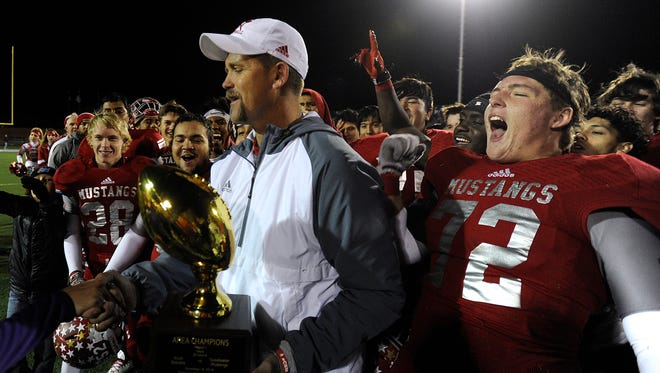 Sweetwater head coach Shane Mobley  celebrates with his team after the Mustang's 40-14 win on Friday, Nov. 18, 2016, at Tarleton Memorial Stadium in Stephenville.