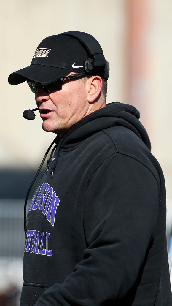 James Madison coach Mike Houston on the sidelines during the FCS championship game against Youngstown State.