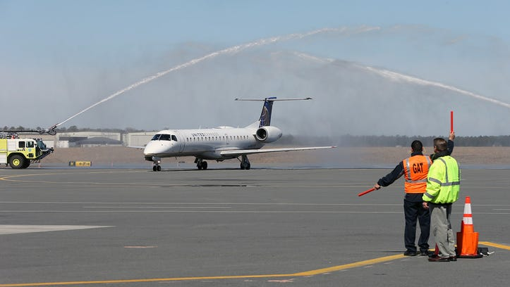 The first United Airlines flight from Chicago is welcomed by water cannons after landing at Atlantic City International Airport on April 1, 2014.