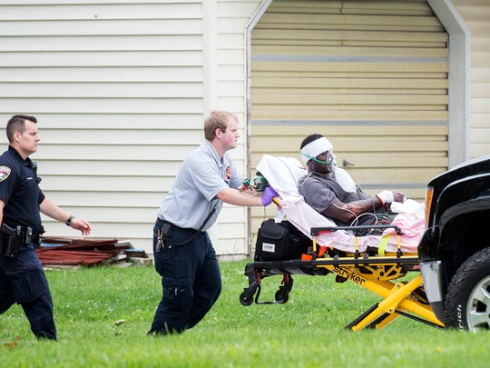 Emergency responders wheel out James Brown Jr., 49, after a police incident in Hanover on Monday.