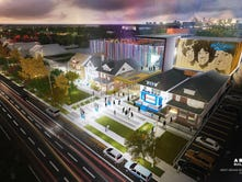 The project envisions another 40,000 feet, with new interactive exhibits, a theater, recording studios, a larger store and more parking.