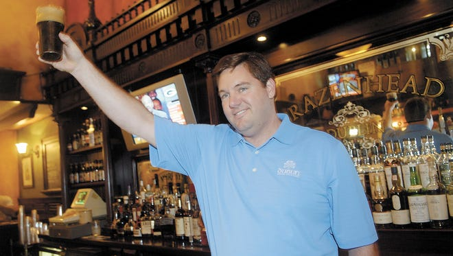 In this Aug. 1, 2008 photo, John T. Fleming, Dublin, Ohio's Irish Festival honorary chairman, proposes at toast following the tapping of the first Dublin Stout Keg at Brazenhead in this Columbus suburb.