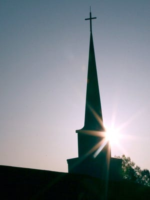 Rays of the Easter Sunday sun April 5, 2015 beam near the steeple at Asbury Baptist Church in Anderson.