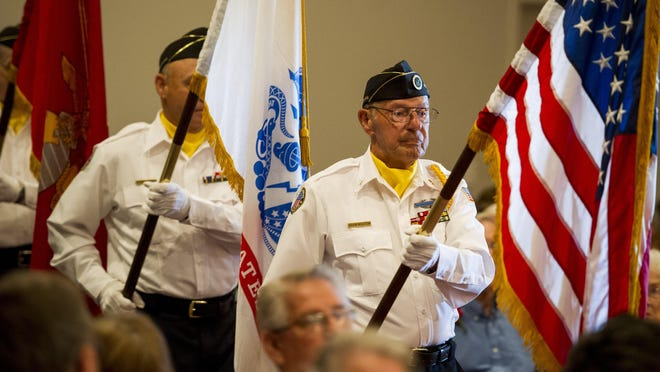 Acadiana Veterans Honor Guard members carry flags during a Memorial Day service at Fountain Memorial Funeral Home. Members of the Acadiana Veterans Honor Guard carry the American flag and flags of the armed forces during a Memorial Day service at Fountain Memorial Funeral Home in Lafayette, La., Monday, May 25, 2015.