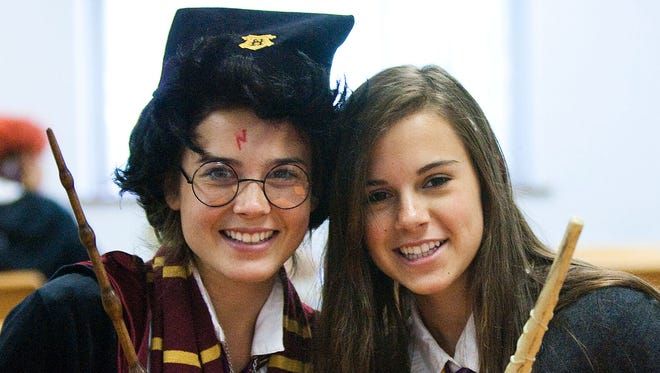 Maggie Reynolds (left) and Ciera Schmidt, both 14 of Hartland, pose for a photo in their wizard costumes during the Harry Potter Horcrux Hunt sponsored by the Hartland Public Library on Thursday, July 14, 2011. The Franklin Public Library will be hosting a whole week of wizarding activities for the 20th anniversary of the first Harry Potter book from July 31 through Aug. 5.