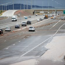 Runoff from a monsoon storm Aug. 19 floods the northbound lanes of Interstate 17 in the North Valley. For a time, the northbound I-17 was reduced to one lane.