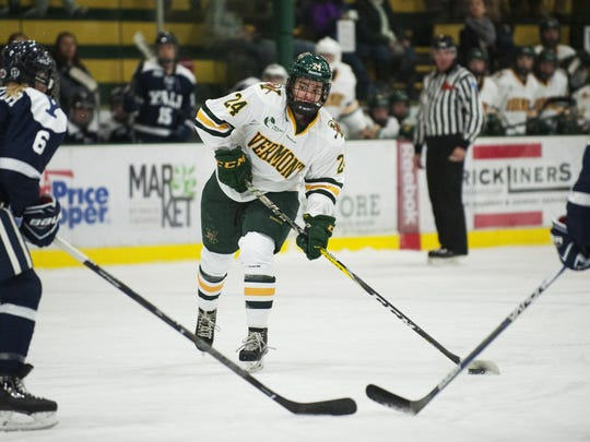 Vermont's Saana Valkama (24) takes a shot during the women's hockey game between the Yale Bulldogs and the Vermont Catamounts at Gutterson Fieldhouse on Saturday.