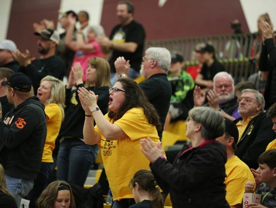 Fans cheer on the Cougars. Cascade falls to Seaside