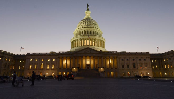 Night falls on the Capitol on the eve of a government shutdown in Washington, D.C.