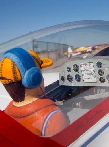 Model airplanes are completed with a pilot and a dashboard at Superstition Field in Apache Junction on Saturday, August 29, 2015.