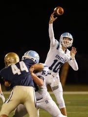 Sparta quarterback Matt Maute throws in the first half
