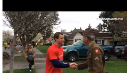 Runners give a WWII veteran a spontaneous tribute during a San Jose 8K.