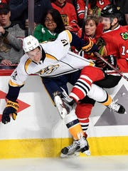 Nashville Predators center Calle Jarnkrok (19) and Chicago Blackhawks right wing Richard Panik (14) collide in the third period of game one in the first-round NHL playoff series at the United Center, Thursday, April 13, 2017, in Chicago, Ill.